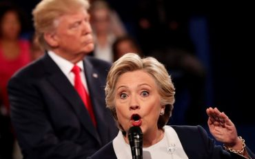 epa05579048 Republican Donald Trump (L) and Democrat Hillary Clinton (R) during the second Presidential Debate at Washington University in St. Louis, Missouri, USA, 09 October 2016. The third and final debate will be held 19 October in Nevada.  EPA/RICK T. WILKING
