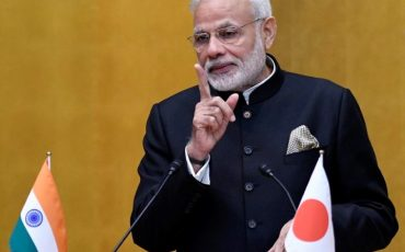epa05626244 Indian Prime Minister Narendra Modi delivers a speech at the start of a luncheon hosted by the Keidanren (Japan Business Federation) in Tokyo, Japan, 11 November 2016. Modi is currently on a three-day visit to Japan.  EPA/FRANCK ROBICHON