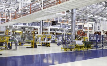 Kragujevac, SU, Serbia - September 23, 2012:  industrial building interior at cars factory, the photo was taken at FIAT car factory during the open day and presentation of a new land vehicle model FIAT 500L