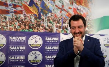 Right-wing, anti-immigrant and euroskeptic League's Matteo Salvini smiles at the end of  a press conference on the preliminary election results, in Milan, Monday, March 5, 2018. The League jumped from 4 percent of the vote five years ago to nearly 18 percent in Sunday's vote, ahead of Forza Italia, which had nearly 14 percent. (AP Photo/Luca Bruno)