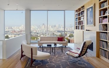 small-apartment-decorating-ideas-with-white-tufted-sofa-design-plus-round-glass-coffee-table-also-lounge-chair-and-bookshelf