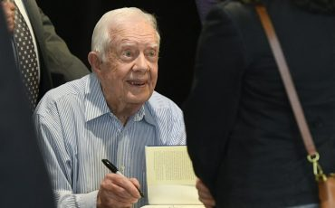 "Former President Jimmy Carter signs copies of his new book ""Faith: A Journey For All"" Wednesday, April 11, 2018, in Atlanta. The book will debut at no. 7 on the New York Times best sellers list. (AP Photo/John Amis)"