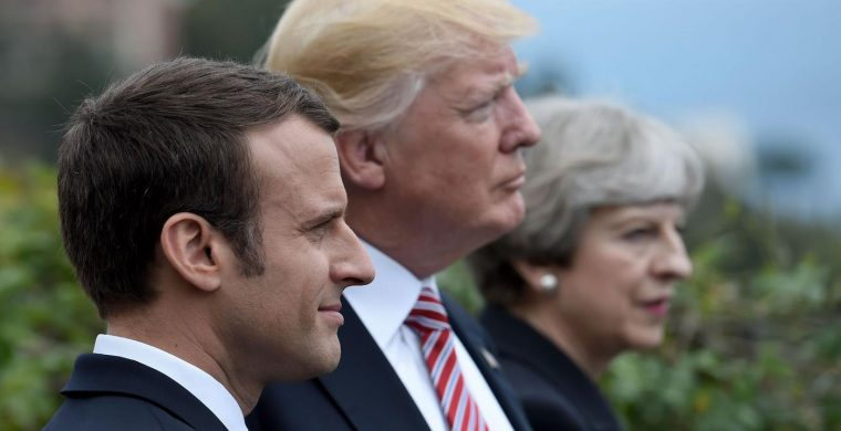 (FILES) This file photo taken on May 26, 2017 shows (L-R) French President Emmanuel Macron, US President Donald Trump and Britain's Prime Minister Theresa May attending the Summit of the Heads of State and of Government of the G7 plus the European Union in Taormina, Sicily. The US, Britain and France ordered overnight on April 14, 2018 a major military operation by deciding to conduct joint strikes against the Syrian regime of Bashar al-Assad in response to alleged chemical weapons attacks. / AFP PHOTO / STEPHANE DE SAKUTIN